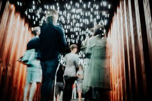 A blurry and atmospheric image of people at MIF